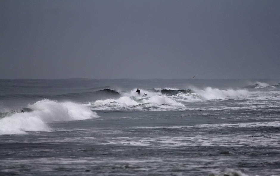 Surfers hit the morning lineup to catch a bit of West Wind after a long dead period in the surf last week