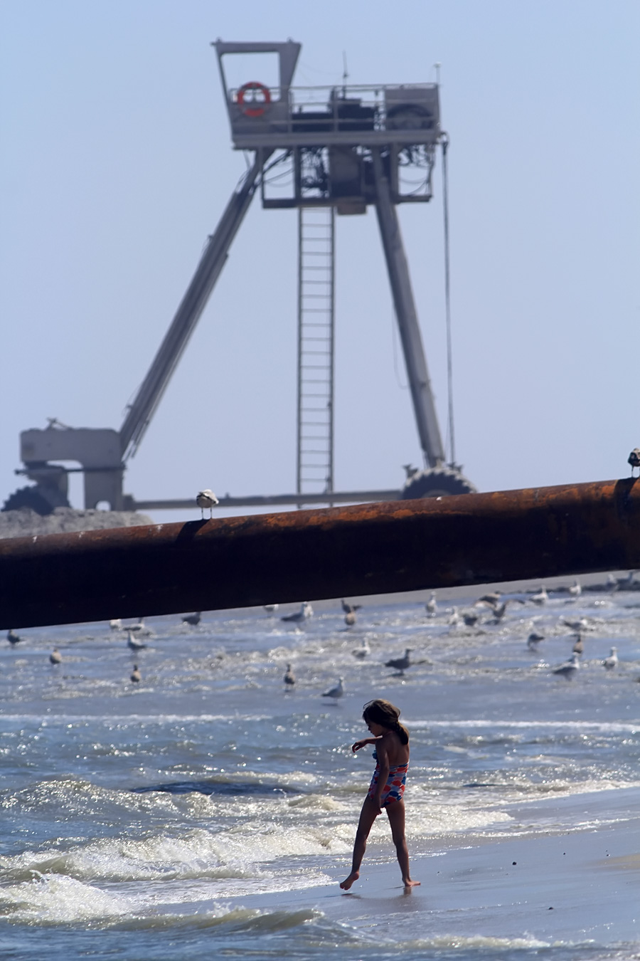 """""""Sure sweetie, you can swim. Just in addition to watching for rip tides & sharks, watch out for that huge rust pipe and don't get bulldozed."""""""